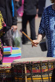 Drums played by women in brightly colored clothes — Stock Photo