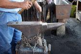 Blacksmith hammers nails — Stock Photo