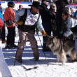 Cowboy skier and friendly dog — Stock Photo #41060383