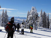 Skiers and snowboarders on top of Storm Peak — Stock Photo