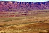 Highway runs under Vermillion Cliffs   — Stock Photo