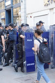 Police in riot gear await orders during a protest  — Stock Photo