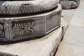 Elaborately decorated bases of the massive columns — Stock Photo