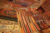 Overlapping carpets with intricate Kurdish  patterns — Stock Photo