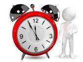 Uomo con un orologio di allarme — Foto Stock