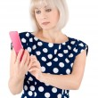 Stock Photo: Blonde with a red mobile phone