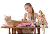 The girl sews toys from fabric — Stock Photo