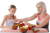 Mother and daughter drinking tea — Stock Photo