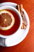 Cup of hot tea on wooden background — Stock Photo