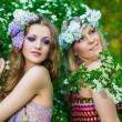 Portrait of two young beautiful women outdoors — Stock Photo