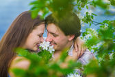 Two Summer Lovers Embracing in a park — Stock Photo