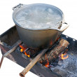 Preparing food on campfire - Stock Photo