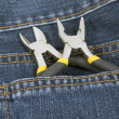 Stock Photo: Tools and jeans pocket