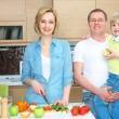 Family on kitchen — Stock Photo #13276205