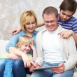 Stock Photo: Family with gadgets