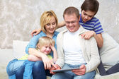 Family with gadgets — Stock Photo