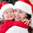 Mom and daughter in Christmas — Stock Photo