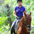 Girl on horse - Stock Photo
