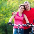 Mature couple on bicycle — Stock Photo