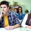 Students on exam in class — Stock Photo #13303899
