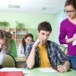 Teacher with group of students in classroom — Stock Photo #13303900