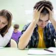 Students on exam in class — Stock Photo #13303904