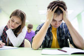 Students on exam in class — Foto de Stock