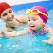 Foto Stock: Baby swimming