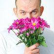 Man with flowers — Stock fotografie