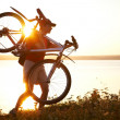 Cyclist walks with his bike  — Stock Photo