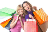 Girlfriends on shopping — Stock Photo