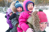Family in wintertime — Stock Photo