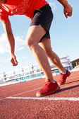 Runner on stadium — Stock Photo