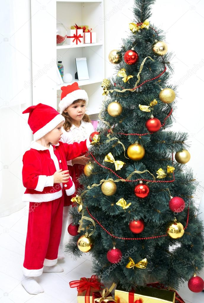 Cute little boy and girl decorating Christmas tree  Stock Photo #13806078