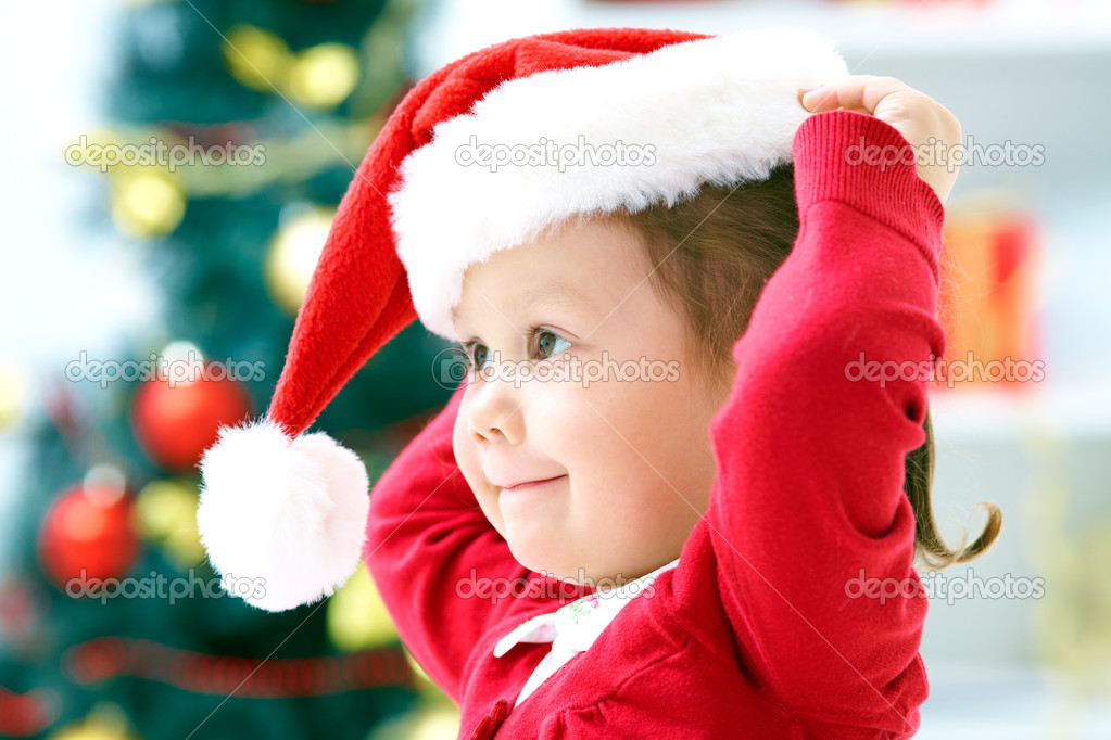 Portrait of little cute girl with Christmas present — Stock Photo #13806086