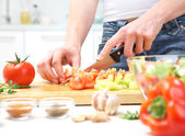 Hands cooking vegetables salad — Stock Photo