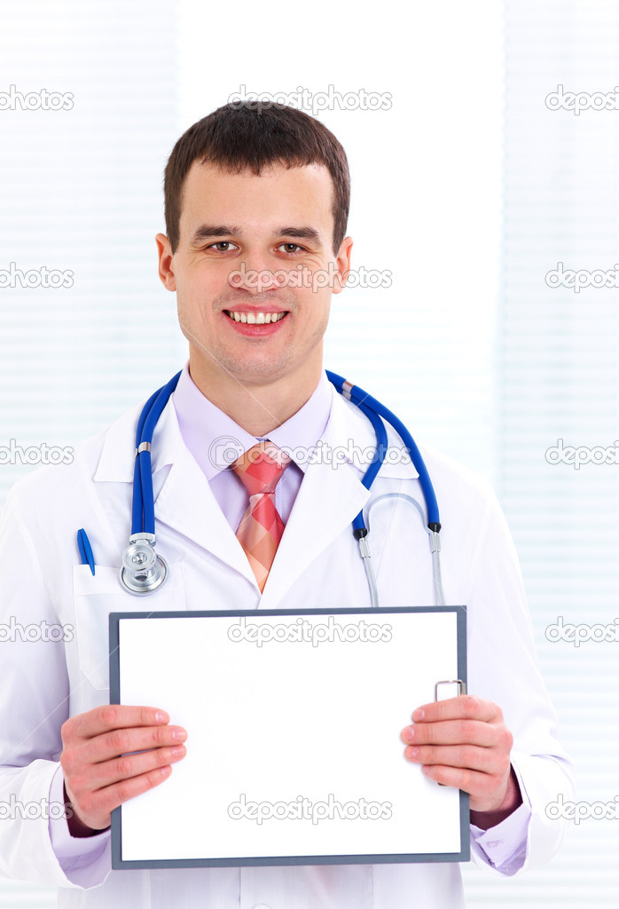 Male doctor in  white coat shows  blank tablet — Stock Photo #14084727
