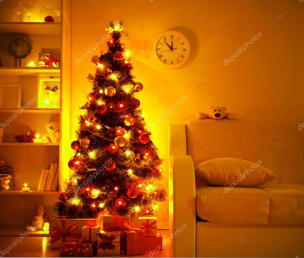 A lighted Christmas tree with presents underneath in living room — Stock Photo #14085660