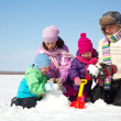 Happy family making snowman — Stock Photo #14535931