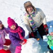 Happy family making snowman — Stock Photo #14535953