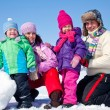 Happy family making snowman — Stock Photo #14535959