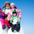 Happy family making snowman — Stock Photo #14535963