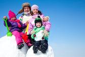 Happy family making snowman — Stock Photo