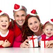 Happy family celebrating Christmas - Stok fotoğraf