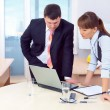 Boss and woman working in office - Foto Stock
