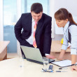 Boss and woman working in office - Stock Photo