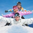 Friends in winter resort - Stock Photo