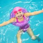Little girl swimming — Stock Photo #19053053