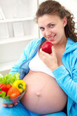 Pregnant woman and healthy food — Stock Photo