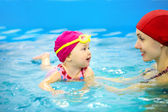 Baby swimming — Stock Photo
